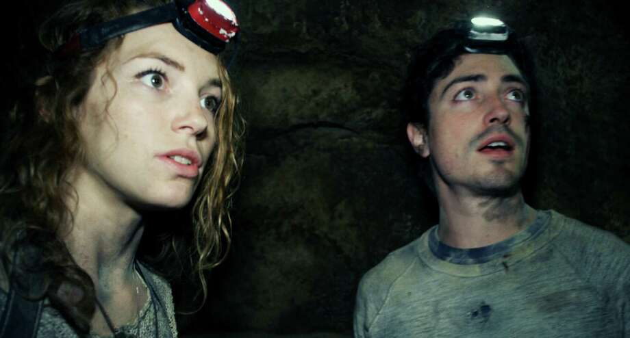 "This image released by Universal Pictures shows Perdita Weeks, left, and Ben Feldman in a scene from the film, ""As Above, So Below."" (AP Photo/Universal Pictures) ORG XMIT: NYET719 / Universal Pictures"