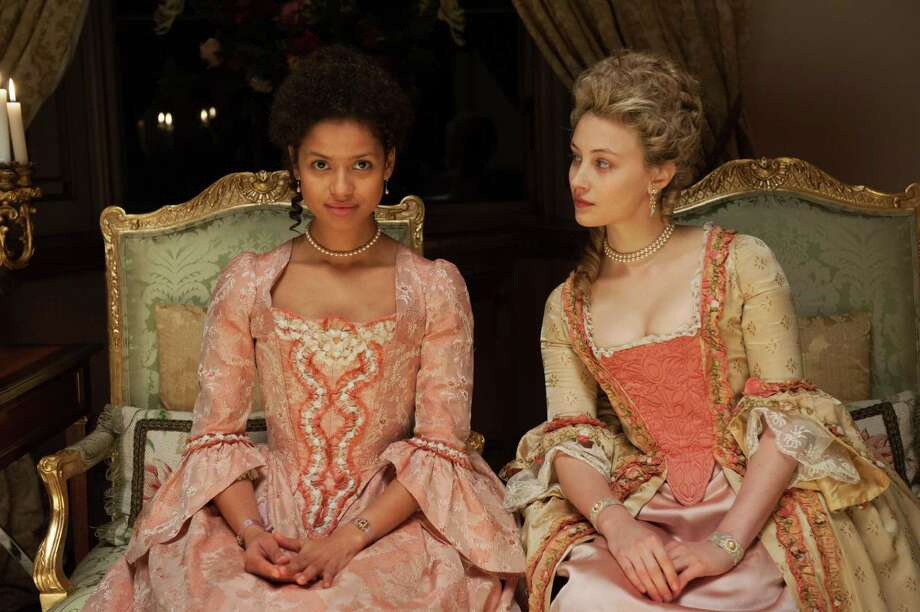 "This photo released by Fox Searchlight shows Gugu Mbatha-Raw, left, as Dido Elizabeth Belle and Sarah Gadon as Lady Elizabeth Murray, in a scene from the film, ""Belle."" The movie releases in US theaters on Friday, May 2, 2014. (AP Photo/Fox Searchlight, David Appleby) ORG XMIT: CAET339 Photo: David Appleby / Fox Searchlight"