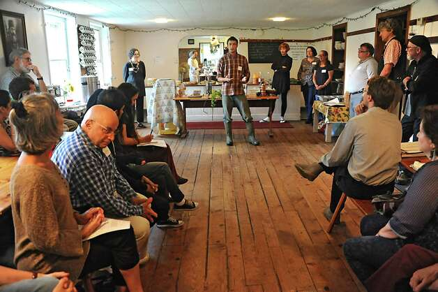 """Evan Thaler-Null, who runs Abode Farm CSA, talks about how horses are used on the farm during a media preview for Behold! New Lebanon, a """"living museum of contemporary rural life"""" at the Abode Farm Thursday, Aug. 21, 2014, in New Lebanon, N.Y. (Lori Van Buren / Times Union) Photo: Lori Van Buren / 00028264A"""