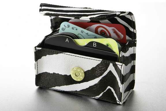 Like a mini-clutch handbag, the Card Cubby offers one-stop shopping for as many as 40 plastic cards or 80 business cards.