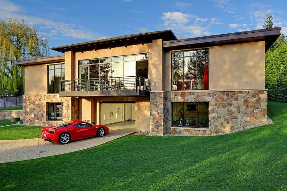 Lower garage, driving to car lift, of a house for car collectors in Bellevue. Photo: Courtesy Tere Foster/Windermere Real Estate