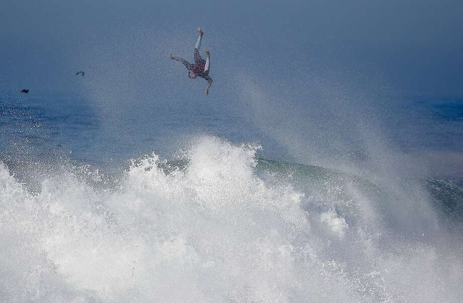 A surfer flies off a wave at the wedge in Newport Beach, Calif., Wednesday, Aug. 27, 2014. Southern California beachgoers experienced much higher than normal surf, brought on by Hurricane Marie spinning off the coast on Mexico. (AP Photo/Chris Carlson) Photo: Chris Carlson, Associated Press