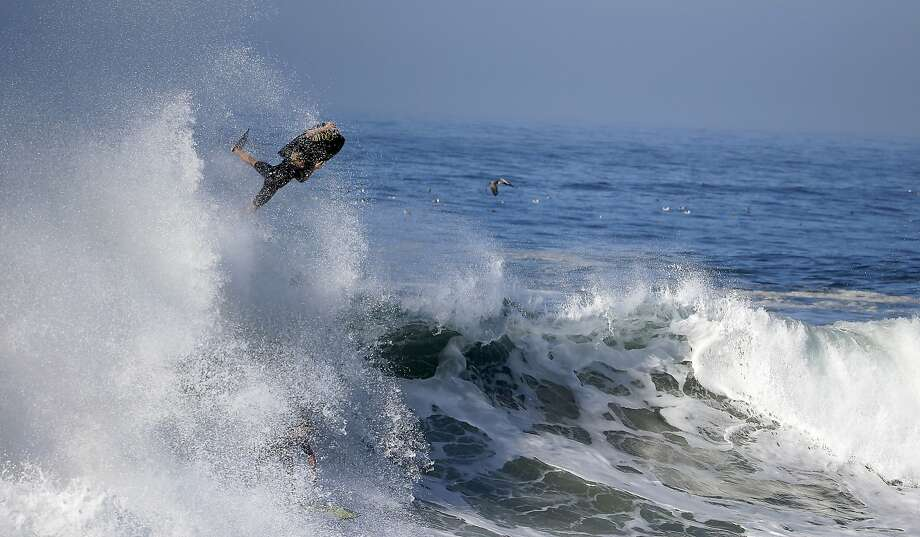 A bogieboarder flies over a wave a surfer rides underneatch a wave at the wedge in Newport Beach, Calif., Wednesday, Aug. 27, 2014. Southern California beachgoers experienced much higher than normal surf, brought on by Hurricane Marie spinning off the coast of Mexico. Photo: Chris Carlson, Associated Press