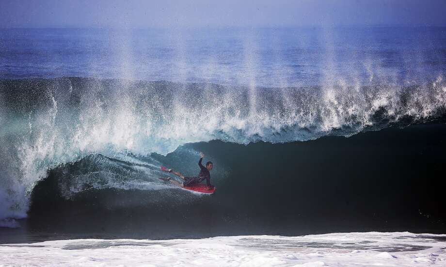 A bogieboarder rides a wave at the wedge in Newport Beach, Calif., Wednesday, Aug. 27, 2014. Southern California beachgoers experienced much higher than normal surf, brought on by Hurricane Marie spinning off the coast of Mexico. Photo: Chris Carlson, Associated Press