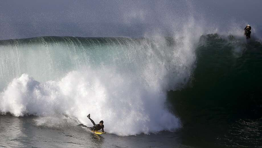 A bogieboarder rides a wave at the wedge in Newport Beach, Calif., Wednesday, Aug. 27, 2014. Southern California beachgoers experienced much higher than normal surf, brought on by Hurricane Marie spinning off the coast of Mexico. (AP Photo/Chris Carlson) Photo: Chris Carlson, Associated Press