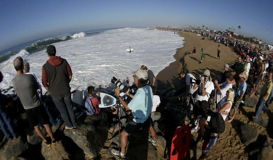 A large crowd gathers to watch surfers and body surfer ride waves at the wedge on Wednesday, Aug. 27, 2014 in Newport Beach, Calif. Beach goers experienced much higher than normal surf, brought on by Hurricane Marie spinning off the coast of Mexico.  Photo: Chris Carlson, Associated Press