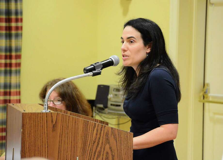 Glen Drive resident Kelly Hennigan speaks at the Planning and Zoning Commission meeting Tuesday, Aug. 26, 2014, at the Lapham Community Center in New Canaan, Conn. Hennigan and a group of other residents oppose the New Canaan Field Club's building expansion project. Photo: Nelson Oliveira / New Canaan News