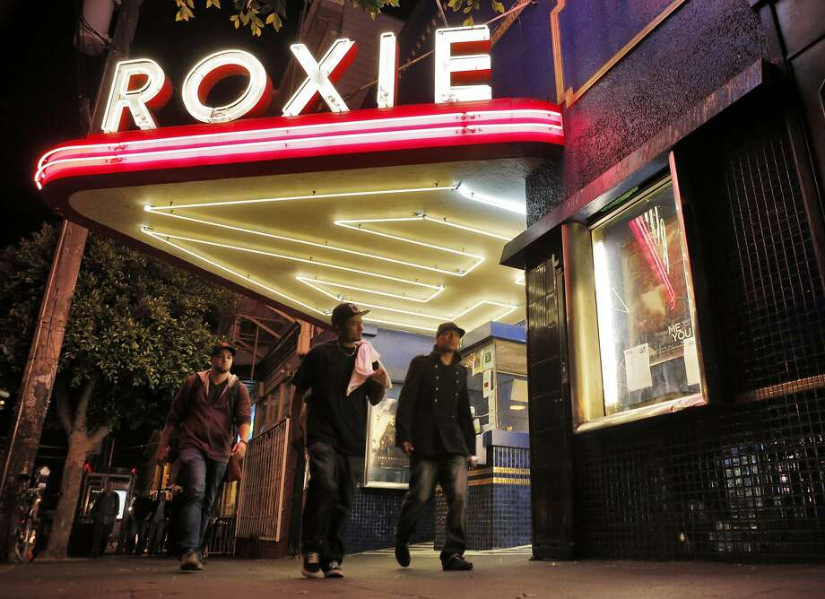 People walk by the Roxie Theater in San Francisco, Calif., on Tuesday, August 26, 2014.  The Roxie is on theater that is fighting the battle for small independent theaters to stay alive. Situated in the Mission, it's a non profit screening house that is getting by with grants, donations and picking obscure, but watchable films. Photo: Carlos Avila Gonzalez, The Chronicle
