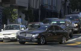 A commuter makes an illegal right turn onto Octavia Boulevard at the last second from a left lane on Oak Street in San Francisco, Calif. on Wednesday, Aug. 27, 2014. Some motorists cut into the right turn lane at the last minute - or make an illegal right turn from the left lanes - creating large backups and irking other drivers.