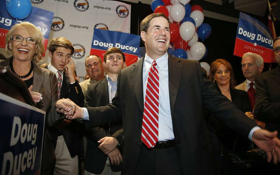 Arizona state Treasurer and former Cold Stone Creamery CEO Doug Ducey is congratulated in Phoenix by Gov. Jan Brewer (left) after winning the Republican primary. Photo: Ross D. Franklin, Associated Press