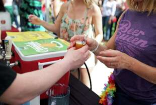CHICAGO, IL - MAY 10:  An attendee samples beer at the American Beer Classic Chicago at Soldier Field on May 10, 2014 in Chicago, Illinois.