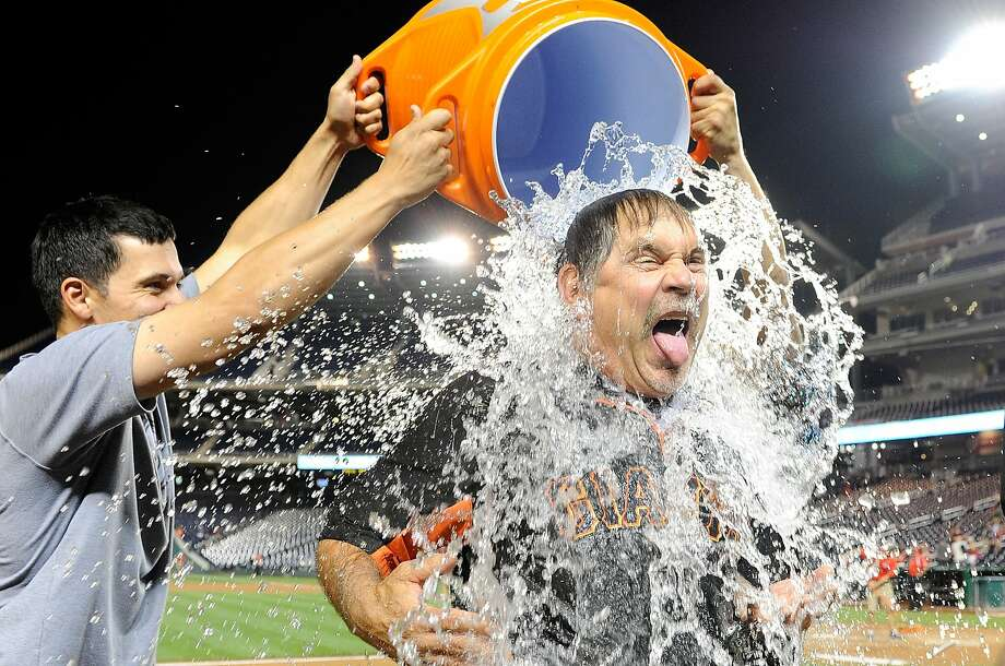 San Francisco Giants manager Bruce Bochy takes the ALS ice bucket challenge after a recent game. Photo: Greg Fiume, Getty Images