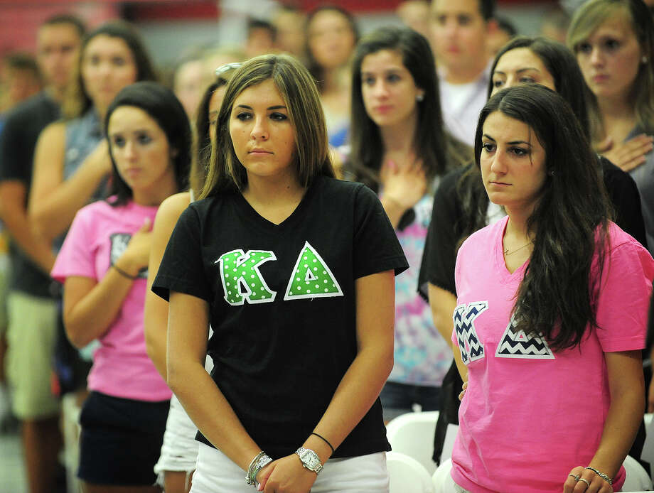 Members of the Kappa Delta sorority stand during the National Anthem at Sacred Heart University's New Student Convocation in Fairfield, Conn. on Wednesday, August 27, 2014. This year's ceremony was in honor of Kaitlyn Doorhy, a member of the sorority and junior at the school who was killed after being hit by a car in Bridgeport on Friday, August 23. Photo: Brian A. Pounds / Connecticut Post