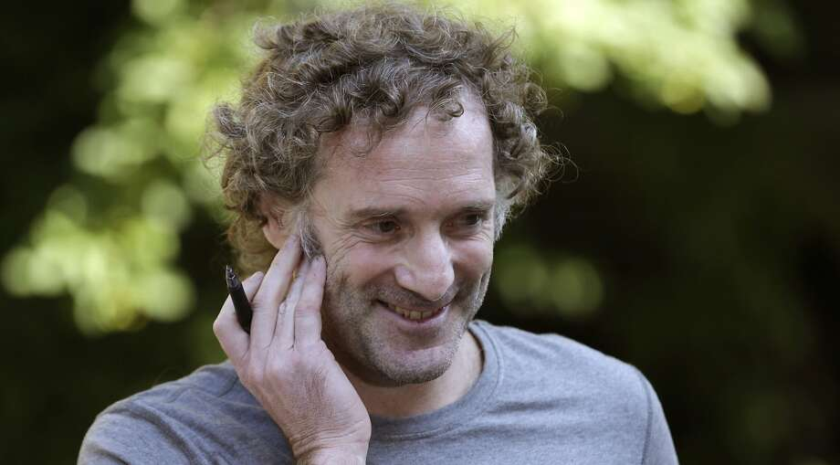 Peter Theo Curtis smiles as he talks with reporters outside his mother's home in Cambridge, Mass. He was held for nearly two years by an al Qaeda affiliate. Photo: Charles Krupa, Associated Press