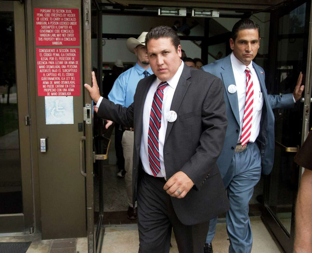 After being acquitted for murder (left) David Barajas walks out of the Brazoria County courthouse a freeman with his defense attorney (right) Sam Cammack III Wednesday August 27, 2014. David Barajas, 32, was accused of shooting Jose Banda, 20, after he struck his two sons, aged 11 and 12, on a rural Texas road in 2012.