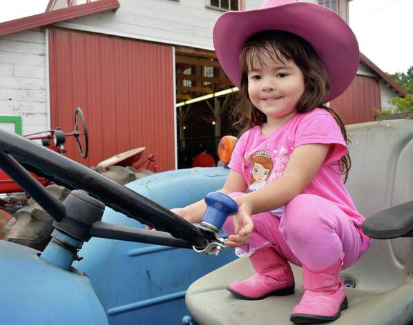 Ellarose Hourigan, 3, of Mechanicville in the drivers seat of a tractor at the 195th Schaghticoke Fair Wednesday August 27, 2014, in Schaghticoke, NY.   (John Carl D'Annibale / Times Union) Photo: John Carl D'Annibale / 00028154A
