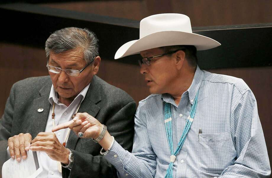 Navajo Nation President Ben Shelly (left), who failed to make the November runoff, speaks with candidate Kenneth Maryboy at a debate this month. Photo: Ross D. Franklin, Associated Press