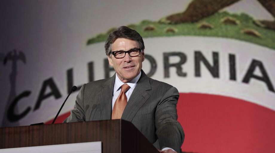 Gov. Rick Perry says his pro-business policies have kept the Texas economy strong, but the state's growth is due mostly to the low cost of housing. Photo: Reed Saxon / Associated Press / AP