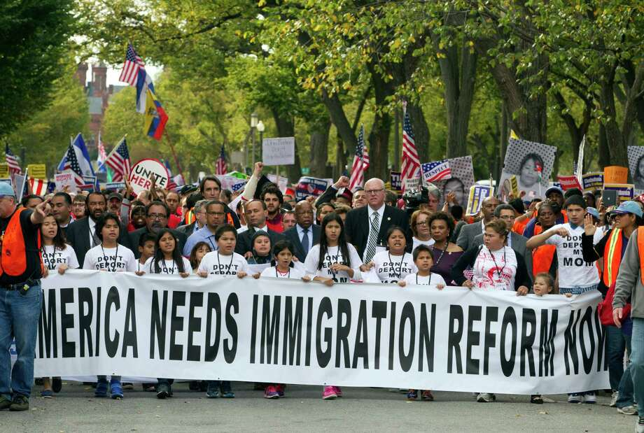 Demonstrators march towards on Capitol Hill during a immigration rally in Washington, on Tuesday, Oct. 8, 2013, seeking to push Republicans to hold a vote on a stalled immigration reform bill. ( AP Photo/Jose Luis Magana) Photo: Jose Luis Magana, FRE / FR159526 AP