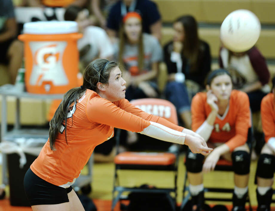 Orangefield's Sabryn Crain, No. 12, returns the ball during Tuesday's match against Jasper.  The Jasper High School volleyball team played against Orangefield at Orangefield on Tuesday afternoon. Photo taken Tuesday 8/26/14 Jake Daniels/@JakeD_in_SETX Photo: Jake Daniels / ©2014 The Beaumont Enterprise/Jake Daniels
