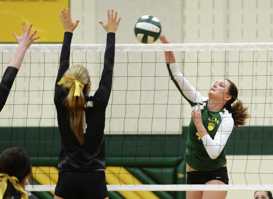 Little Cypress-Mauriceville's Darby Strother, No. 4, goes up for a shot during Tuesday's match against Nederland. The Nederland High School volleyball team played against Little Cypress-Mauriceville at Little Cypress-Mauriceville on Tuesday afternoon.  Photo taken Tuesday 8/26/14  Jake Daniels/@JakeD_in_SETX Photo: Jake Daniels / ©2014 The Beaumont Enterprise/Jake Daniels