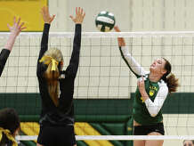 Little Cypress-Mauriceville's Darby Strother, No. 4, goes up for a shot during Tuesday's match against Nederland. The Nederland High School volleyball team played against Little Cypress-Mauriceville at Little Cypress-Mauriceville on Tuesday afternoon.  Photo taken Tuesday 8/26/14  Jake Daniels/@JakeD_in_SETX