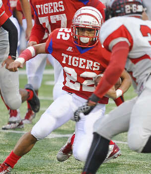 Martin Tiger's Juan Valdivia (22) manuevers through Victoria West's defense, Saturday evening at Shirley Field. Photo: Danny Zaragoza / LAREDO MORNING TIMES