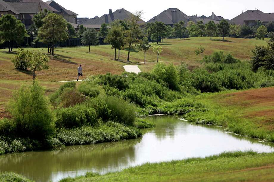 A dry detention area in Cinco Ranch is an environmentally friendly alternative to the usual detention pond. Photo: Gary Coronado, Staff / © 2014 Houston Chronicle
