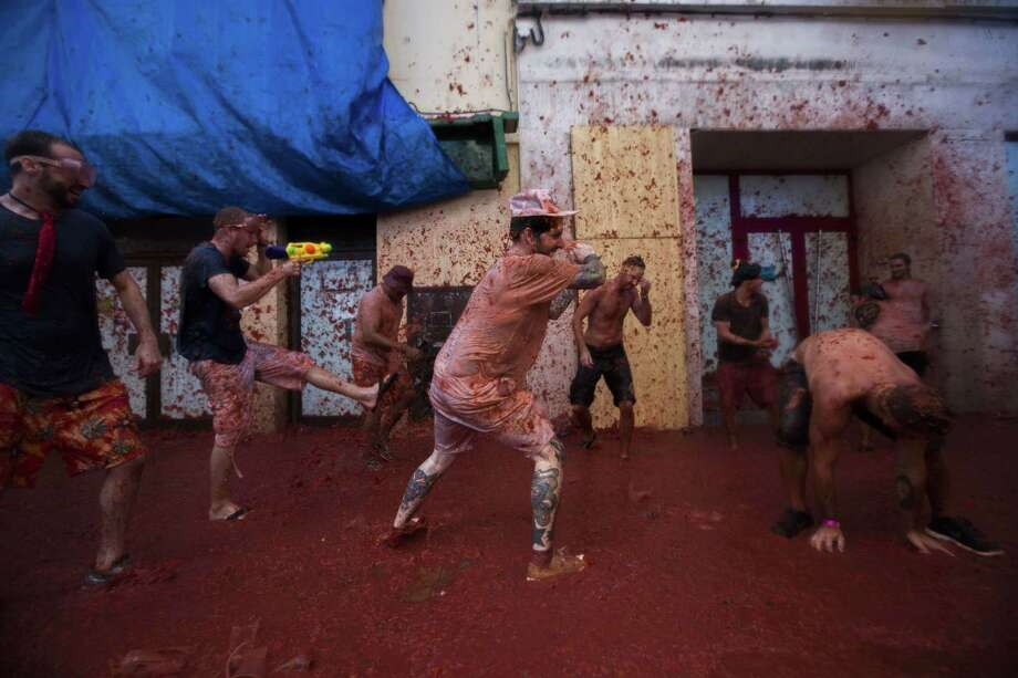 "Revellers take part in the annual  ""tomatina"" festivities in the village of Bunol, near Valencia on August 28, 2013.  Photo: GABRIEL GALLO, AFP/Getty Images / AFP"