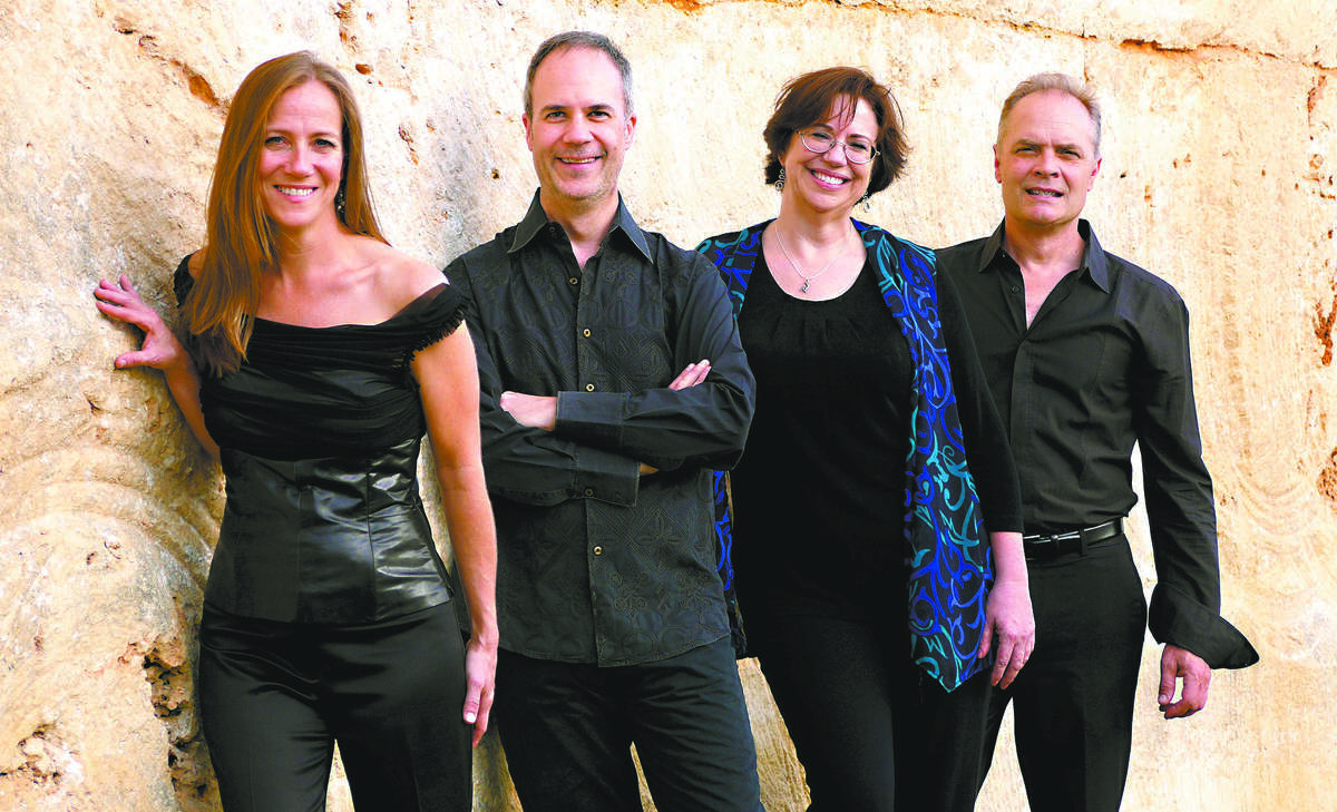 The SOLI Chamber Ensemble comprises (from left) clarinetist Stephanie Key, violinist Ertan Torgul, pianist Carolyn True and cellist David Mollenauer.