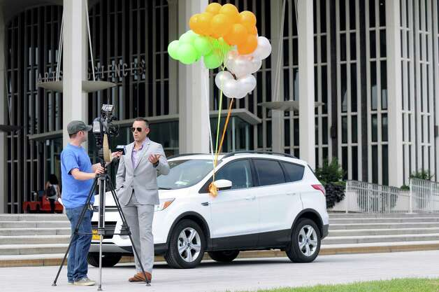Craig Burns, senior manager of university accounts, right, talks about the Zipcar, a car-sharing service, during an interview with Channel 6 News on Wednesday, Aug. 27, 2014, at UAlbany in Albany, N.Y. (Cindy Schultz / Times Union) Photo: Cindy Schultz / 00028337A