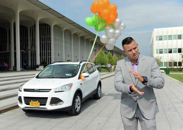 Craig Burns, senior manager of university accounts, talks about the Zipcar, a car-sharing service, on Wednesday, Aug. 27, 2014, at UAlbany in Albany, N.Y. (Cindy Schultz / Times Union) Photo: Cindy Schultz / 00028337A
