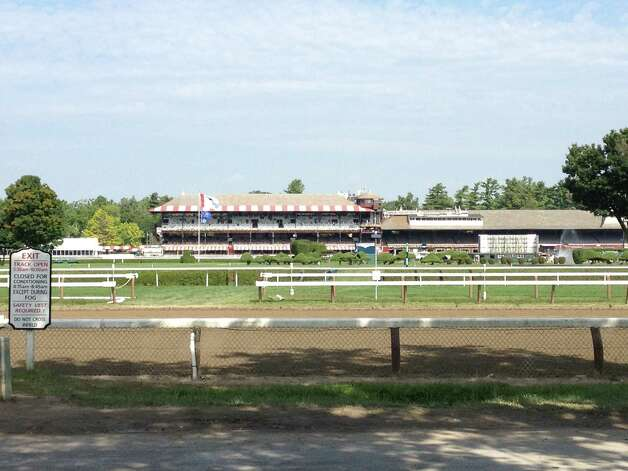 Saratoga Race Course waits for the start of the final six days of racing during the 2014 meet on Wednesday morning in this view from the backstretch. The first 34 days of the season have flown by; those who love the Spa are hoping the last week of racing slows down a bit. The meet ends on Labor Day. —Tim Wilkin