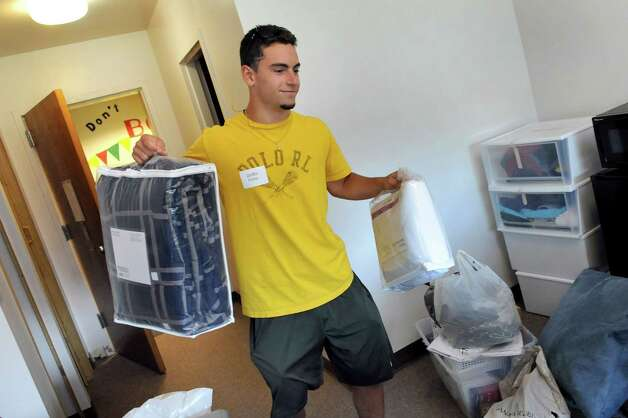 Freshman Griffin Fisher, 18, of Clifton Park settles into his dormitory room on Wednesday, Aug. 27, 2014, at Albany College of Pharmacy and Health Sciences in Albany, N.Y. (Cindy Schultz / Times Union) Photo: Cindy Schultz / 00028343A