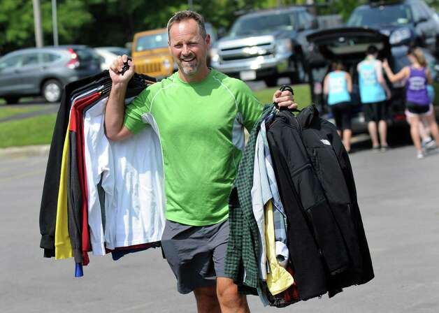 Mike Fisher of Clifton Park carries clothes as he helps his freshman son Griffin, 18, settles into his dormitory room on Wednesday, Aug. 27, 2014, at Albany College of Pharmacy and Health Sciences in Albany, N.Y. (Cindy Schultz / Times Union) Photo: Cindy Schultz / 00028343A