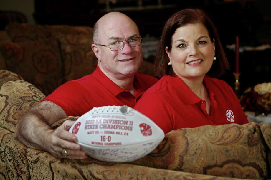 Mike Tawney's passion for Katy is shared by wife Mary. The ball, won by Mike via a booster club's silent auction, was signed by the 2012 state champs. Photo: Gary Coronado, Staff / © 2014 Houston Chronicle