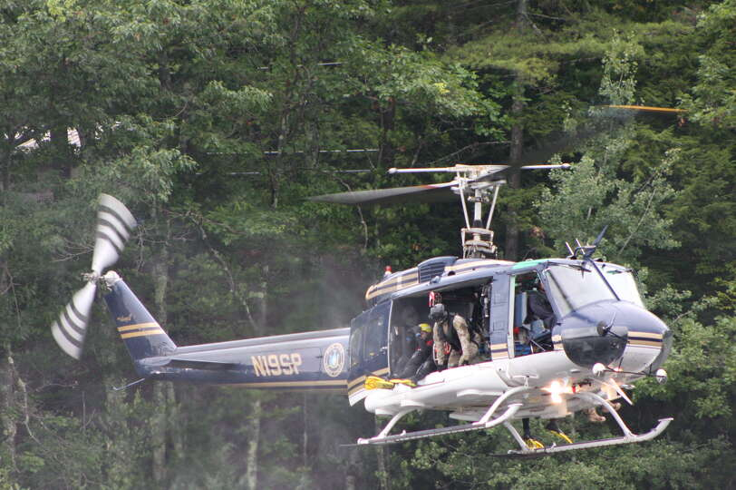 A State Police helicopter conducts an aerial search of the Great Sacandaga Lake before making entry