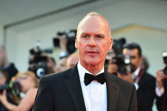 """US actor Michael Keaton arrives for the screening of the movie """"Birdman or the Unexpected Virtue of Ignorance"""" presented in competition at the opening ceremony of the 71st Venice Film Festival on August 27, 2014 at Venice Lido.  AFP PHOTO / GABRIEL BOUYSGABRIEL BOUYS/AFP/Getty Images"""
