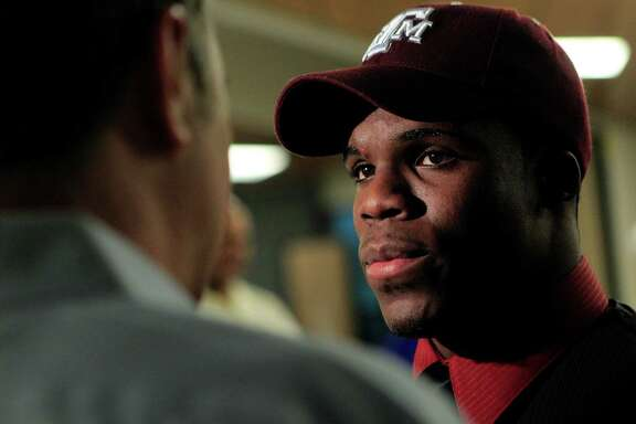 Dekaney High School running back Trey Williams, 19, talks with the media after he signed his letter of intent to play at Texas A&M and Williams signed to play at Stephen F. Austin on National Signing Day at Dekaney High School Wednesday, Feb. 1, 2012, in Spring. ( Johnny Hanson / Houston Chronicle )