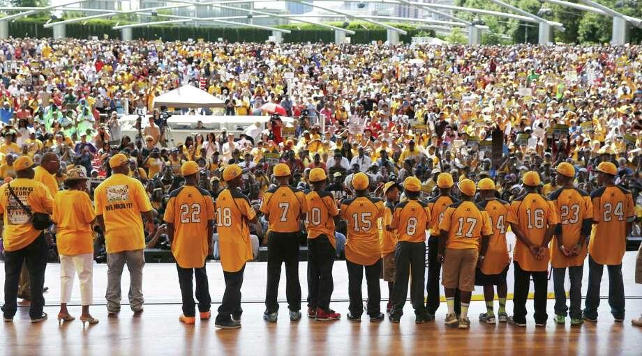 The Jackie Robinson West Little League All-Stars take in the cheers of thousands during a rally in Chicago to celebrate their U.S. championship. Photo: Photos By Charles Rex Arbogast / Associated Press / AP