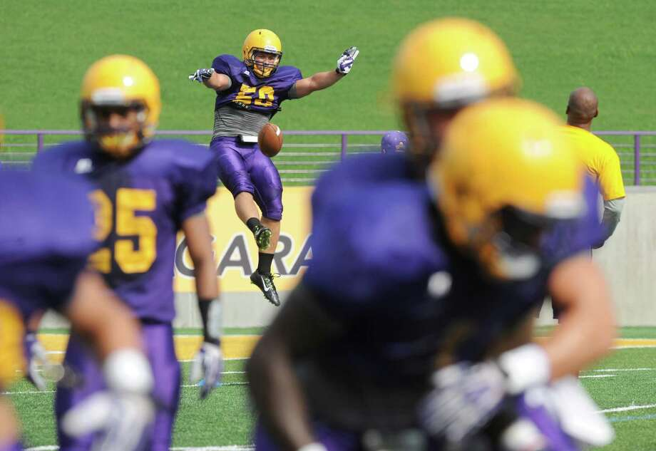 The UAlbany football team practices on Wednesday Aug. 27, 2014 in Albany, N.Y. They open their season on Saturday at home against Holy Cross. (Michael P. Farrell/Times Union) Photo: Michael P. Farrell / 00028354A