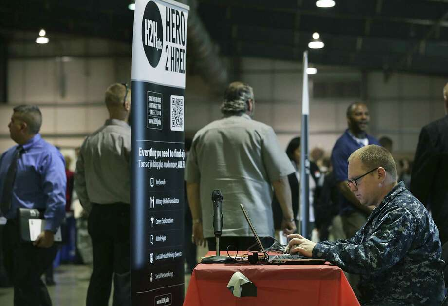Henry Steele enters information in a database called Hero2Hire at the Veterans Information Village and Military Job Fair at the Freeman Coliseum in March. Photo: San Antonio Express-News File Photos / © 2012 San Antonio Express-News