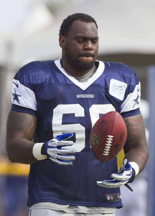Cowboys defensive tackle Henry Melton may see his first action of the preseason while the man he's replacing, Denver's DeMarcus Ware, will sit out. Photo: Ringo H.W. Chiu / Associated Press / FR170512 AP