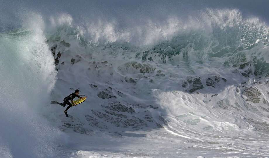 A bogieboarder rides a wave at the Wedge in Newport Beach, Calif. The high surf in Southern California was brought on by Hurricane Marie spinning off the coast of Mexico. Photo: Chris Carlson / Associated Press / AP