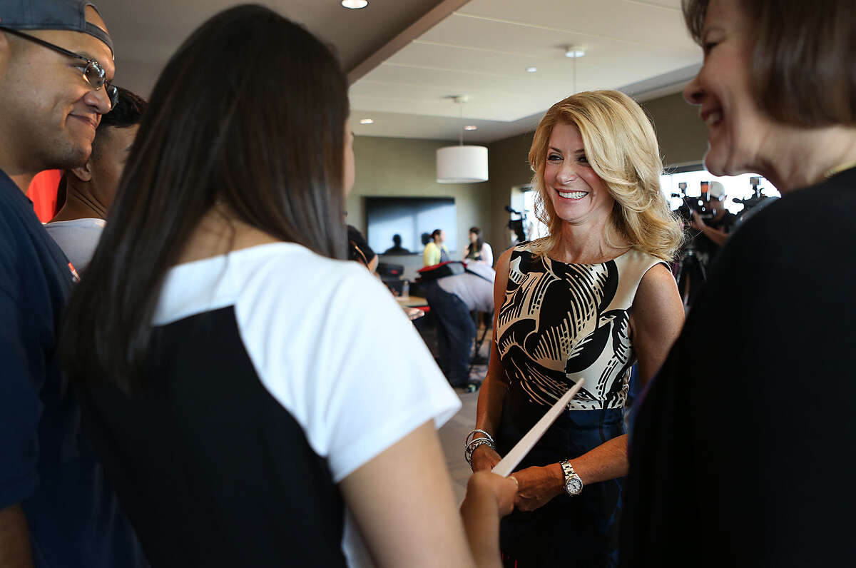 Wendy Davis gave details on finding more money to improve schools, including closing corporate tax loopholes. The campaign of foe Greg Abbott labeled that idea a tax increase.