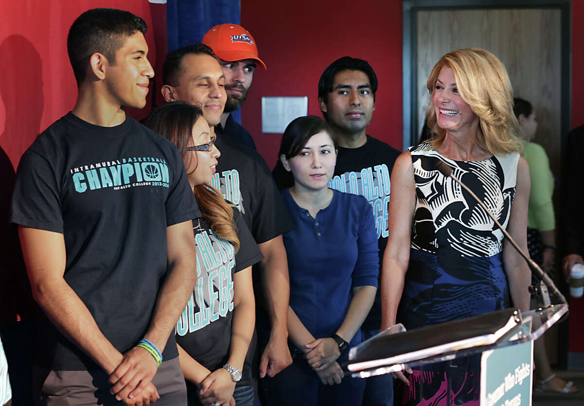 Democrat candidate for Governor of Texas, Senator Wendy Davis, right, smiles at Palo Alto College and UTSA students as she prepares to addressed the media outlining her ideas for higher education, during a press conference at Palo Alto College. Tuesday, Aug. 26, 2014.