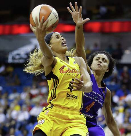 Skylar Diggins, the WNBA's Most Improved Player, raised her scoring from 8.5 points per game in 2013 to 20.1 this season. Photo: Mike Simons, Associated Press / Tulsa World