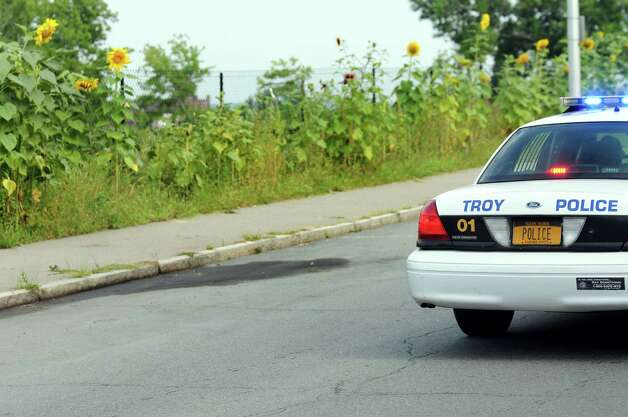A Troy Police car cruises past the scene of a shooting on 8th Street on Wednesday, Aug. 27, 2014, in Troy, N.Y. (Cindy Schultz / Times Union) Photo: Cindy Schultz / 00028353A