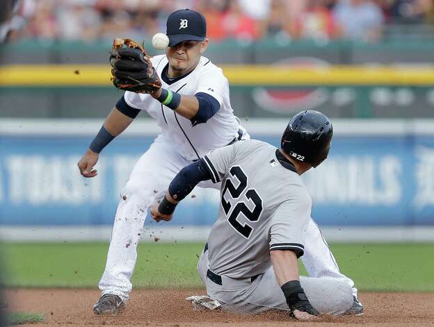 Detroit Tigers shortstop Eugenio Suarez, left, cannot handle the throw as New York Yankees' Jacoby Ellsbury (22) steals second base in the first inning of a baseball game in Detroit, Wednesday, Aug. 27, 2014. (AP Photo/Paul Sancya) ORG XMIT: MIPS105 Photo: Paul Sancya / AP