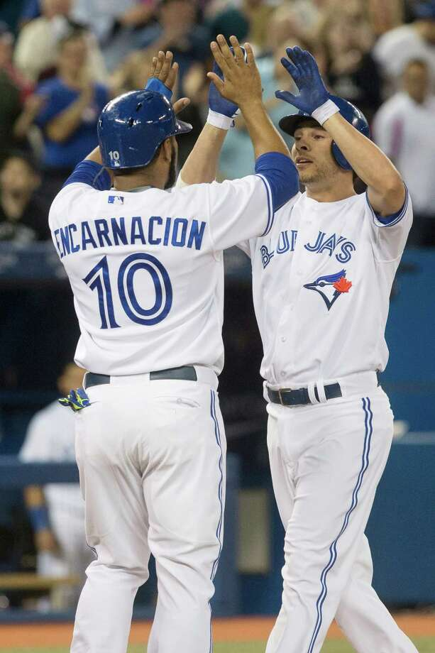 Toronto Blue Jays' Danny Valencia , right, celebrates with teammate Edwin Encarnacion after hitting a three run homer off Boston Red Sox pitcher Junichi Tazawa during seventh inning American League baseball action in Toronto on Wednesday, Aug. 27, 2014. (AP Photo/The Canadian Press, Chris Young) ORG XMIT: CHY115 Photo: Chris Young / CP
